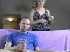 Milf Takes Over Guys Handjob By Sucking Dick