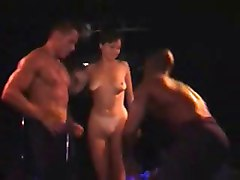 Amateur girls undressed on stage in public