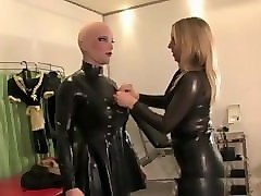 mistress dresses a rubber doll for sex