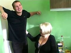 Big tit mamma fucked by 3 young guys in kitchen.