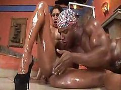 Oiled up black couple are doing a lot of sucking before they fuck