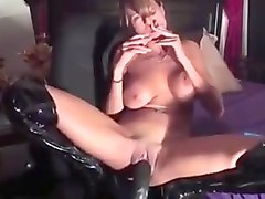Smoking MILF Inserts Huge Dildo
