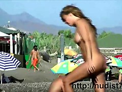 nudist video at the beach has shy girl playing in the water movie