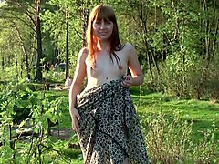 magnificent cute redhead teen babe outdoors flashes her breasts