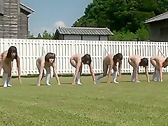 Playful Japanese bimbos run around the soccer field completely naked