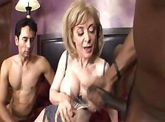 MILF keeps her stockings on while taking on these two cocks