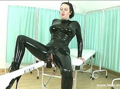 Dark haired chick in latex gets fucked by huge..