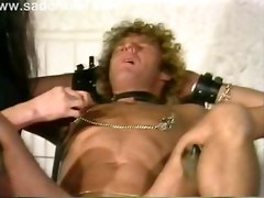 Slave Tied To A Chair Got Clamps And Needles Trough His Nipples En Finger Fucked In The Ass By Mistress