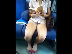 Teen Very Nice In Shorts Reading In Train